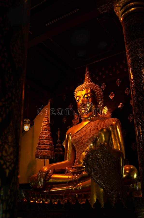 The giant ancient buddha statue in a church of Thailand royalty free stock photo
