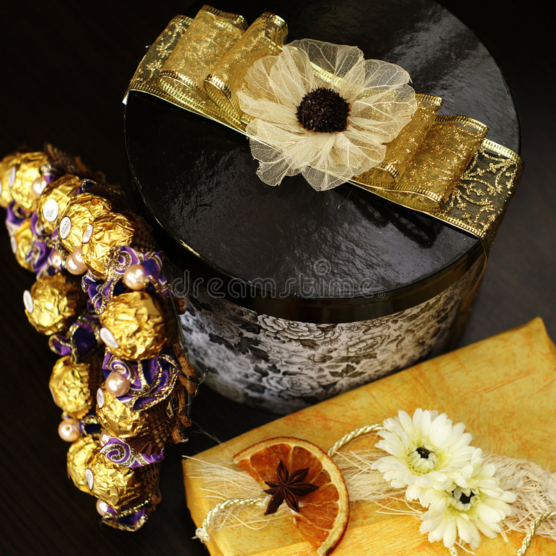 Beautiful Gift. Beautiful presents decorated with flowers and golden ribbons royalty free stock photo