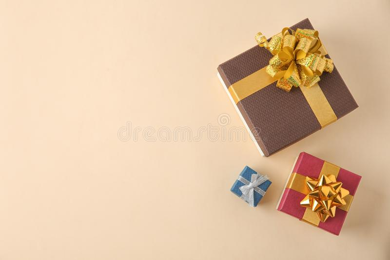 Beautiful gift boxes on beige background. Space for text. Beautiful gift boxes on beige background, flat lay. Space for text royalty free stock photos
