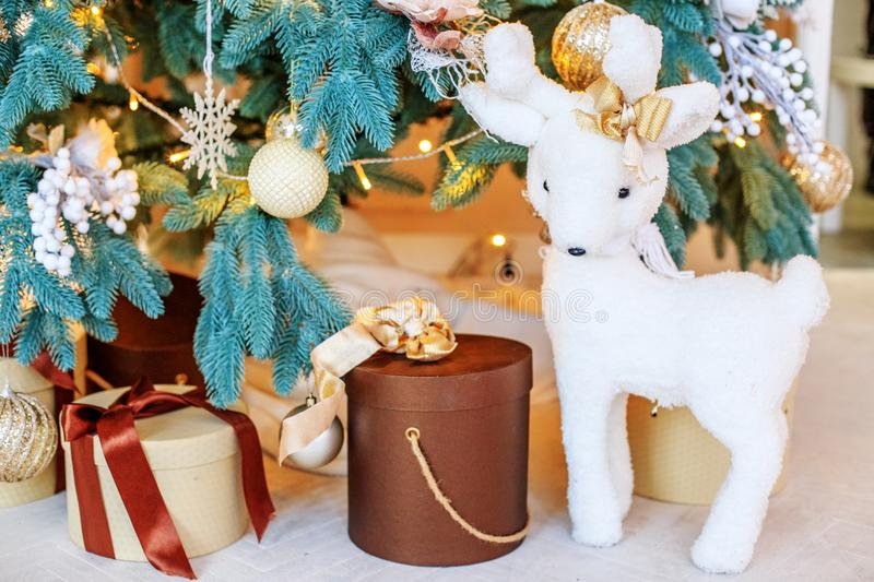 Beautiful gift boxes, deer and fir tree. Background. New Year`s. And Christmas concepts stock photo