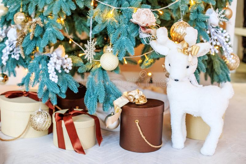 Beautiful gift boxes, deer and fir tree. New Year`s and Christm. As concepts stock image