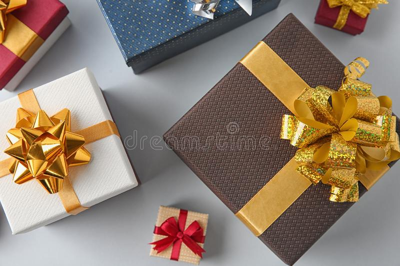 Beautiful gift boxes on white background. Top view royalty free stock photo