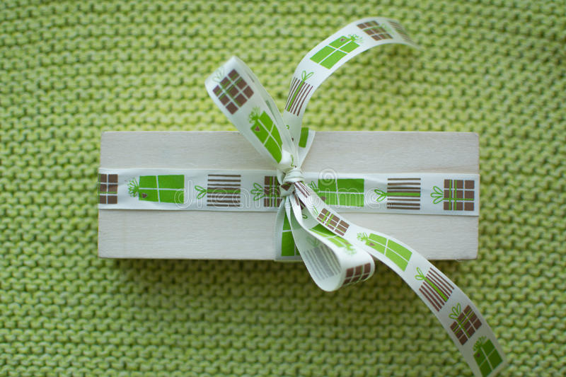 Beautiful gift with a ribbon on a green background stock images