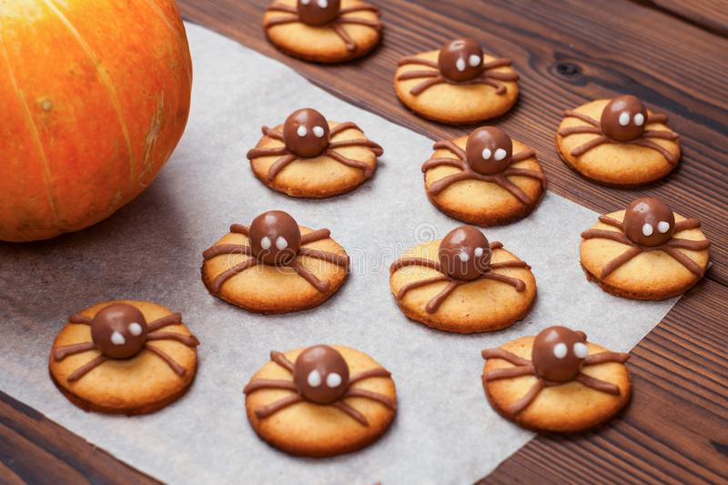 Beautiful gingerbread for Halloween and fresh pumpkin on the table. horizontal view from above. stock images