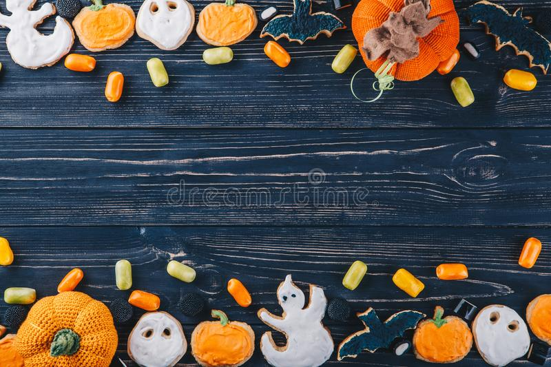 Beautiful gingerbread and sweets for Halloween and pumpkin on the table. Trick or Treat horizontal view from above stock photography