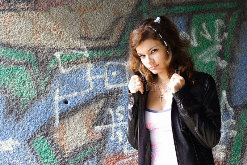 Beautiful girl. In leather jacket royalty free stock photography
