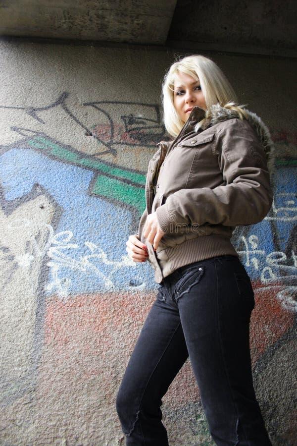 Beautiful girl. Against graffiti wall royalty free stock photos