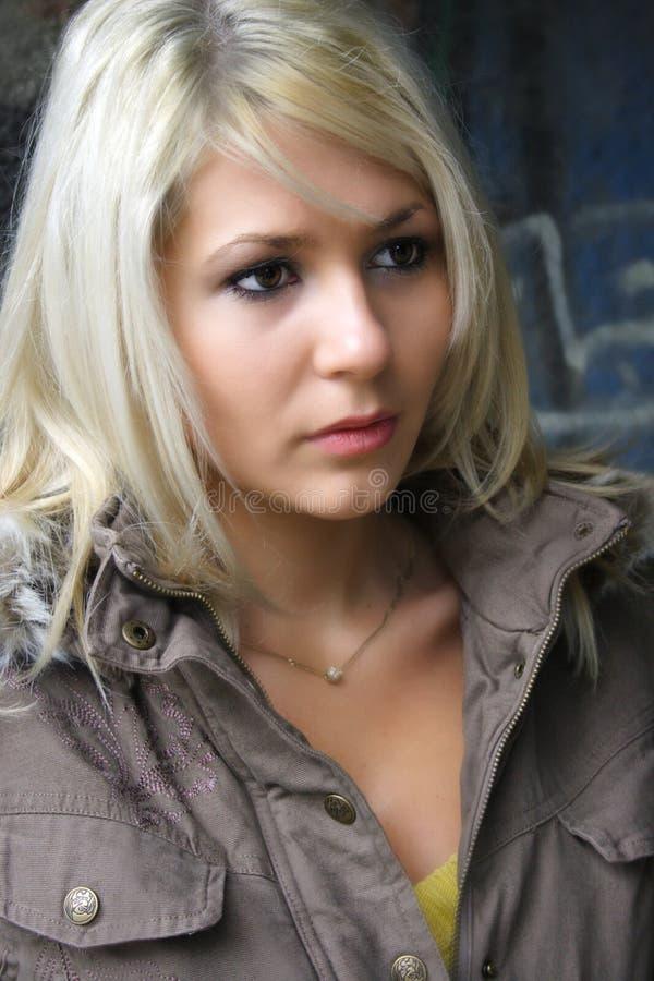 Beautiful girl. Against graffiti wall stock image