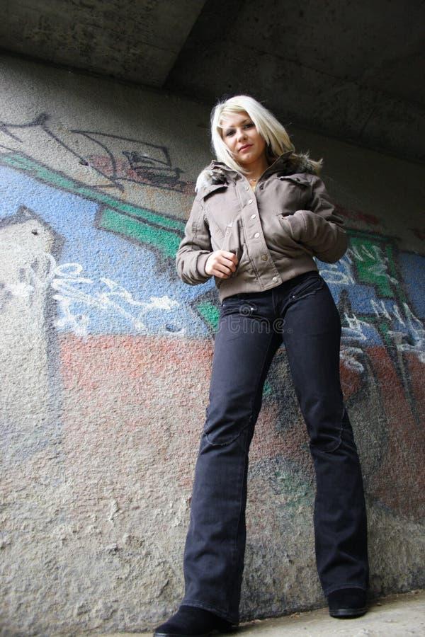 Beautiful girl. Against graffiti wall stock images
