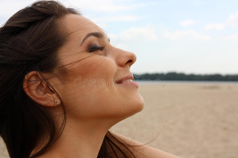 Beautiful girl. The beautiful girl, the brunette blindly, close up on a beach royalty free stock photography