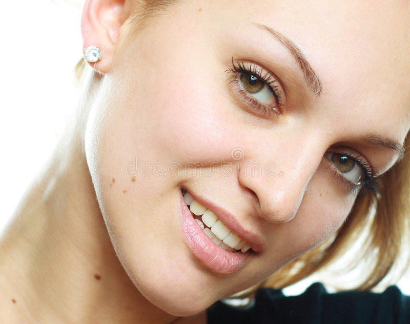 A beautiful girl. With fantastic eyes, look at the camera, smiling royalty free stock image