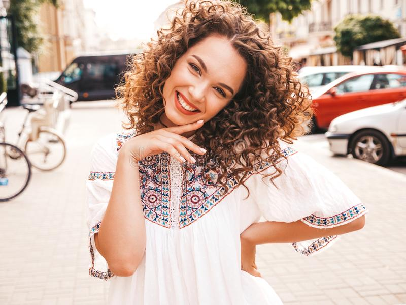Beautiful girl with afro curls hairstyle posing in the street stock photography