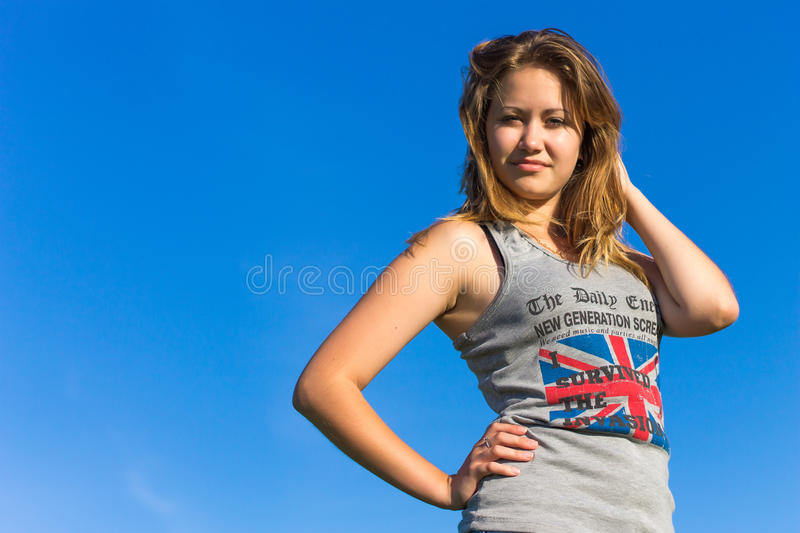 Beautiful girl against the sky royalty free stock images