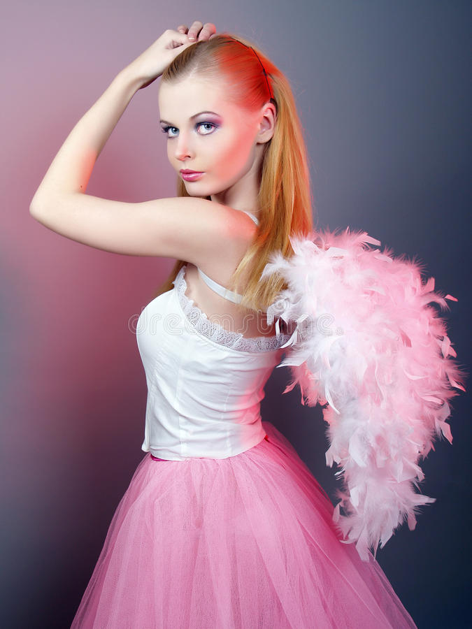 Beautiful girl of angel with big wings stock photos