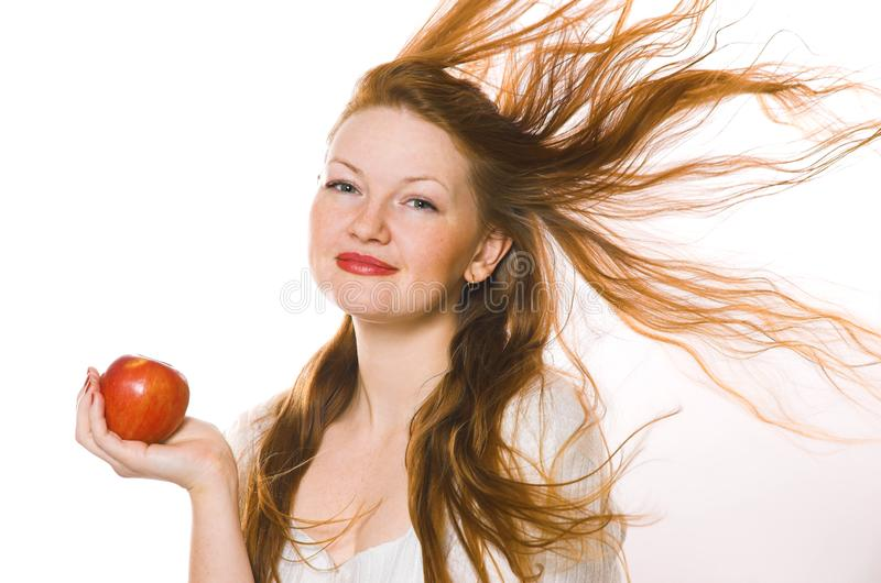The beautiful girl with an apple royalty free stock photos