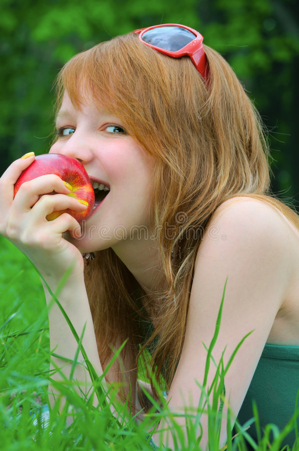 Beautiful girl with apple stock photos