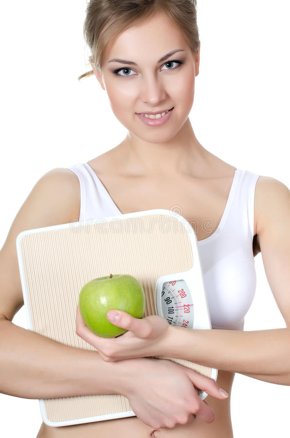 The beautiful girl with apple in hand stock photos