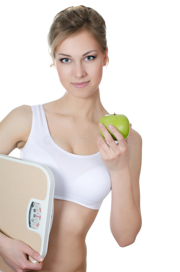 Beautiful girl with apple in hand royalty free stock images