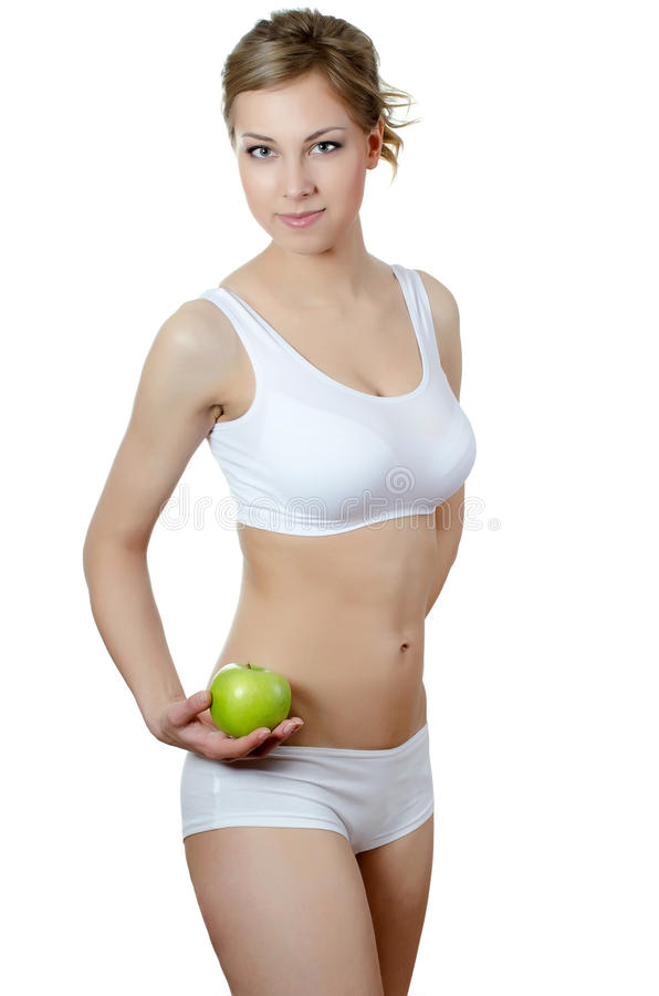 The beautiful girl with an apple in a hand stock images