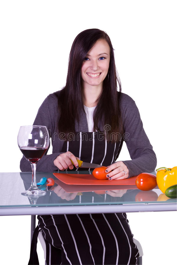 Beautiful Girl With An Apron In The Ktichen Royalty Free Stock Image