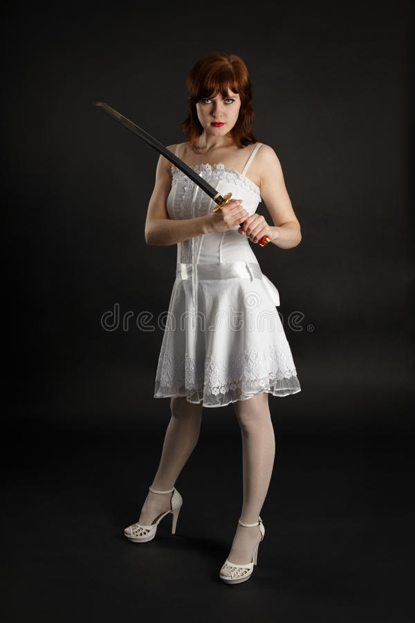 Beautiful girl armed with sword royalty free stock photography