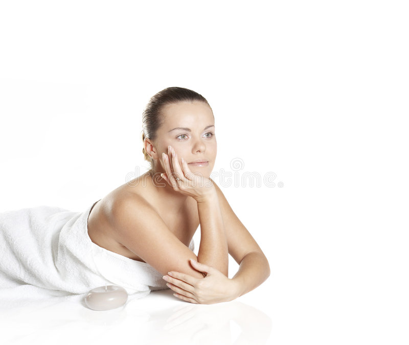 Beautiful girl about aroma by candles. The perfect woman about aromatic candles stock photo
