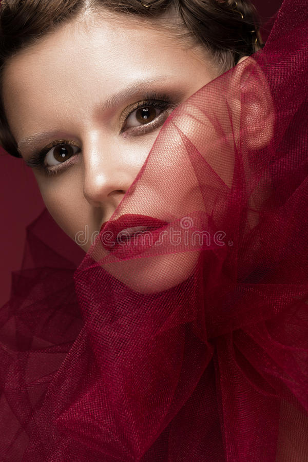 Beautiful girl with art creative make-up in image of red bride for Halloween. Beauty face. royalty free stock image