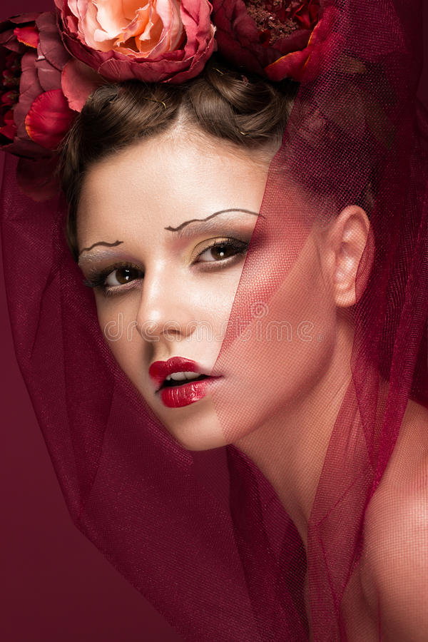 Beautiful girl with art creative make-up in image of red bride for Halloween. Beauty face. royalty free stock images