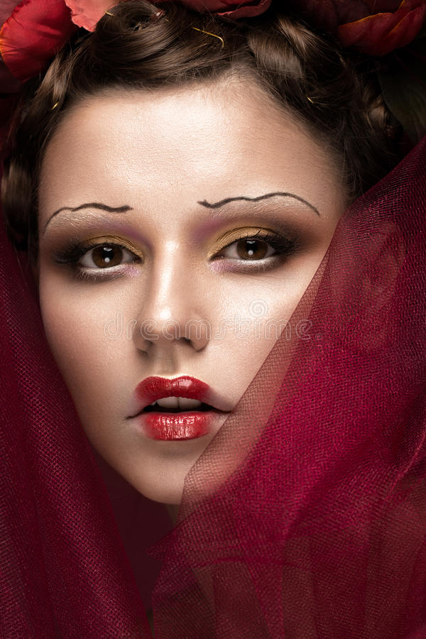 Beautiful girl with art creative make-up in image of red bride for Halloween. Beauty face. royalty free stock photos