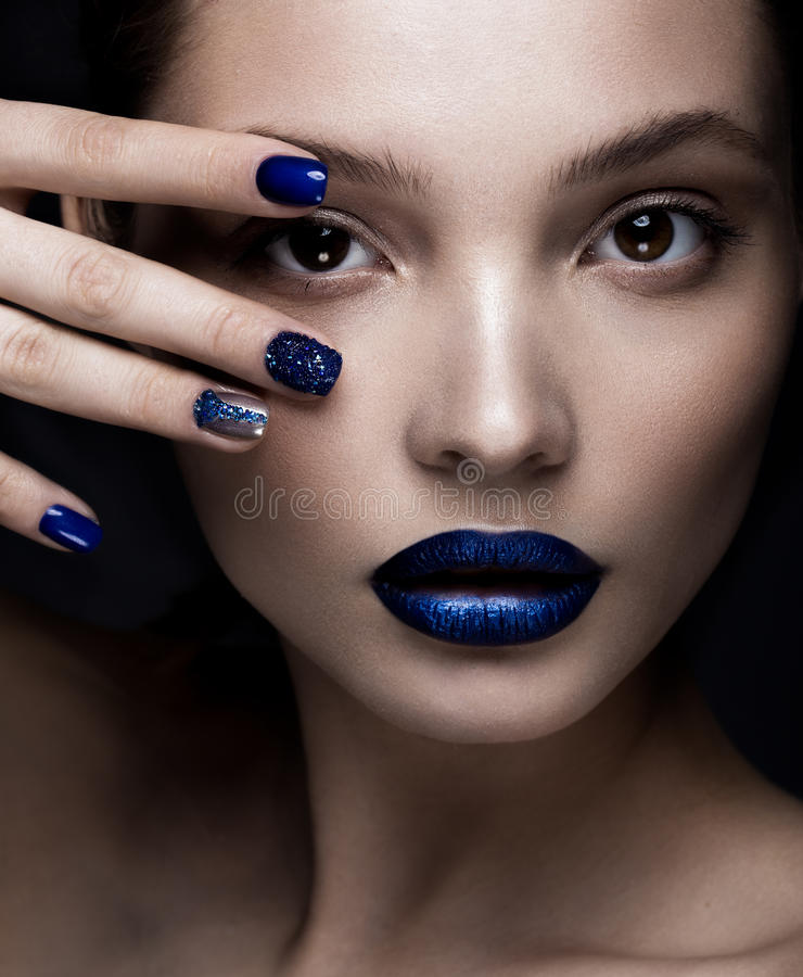Beautiful girl with art make-up, dark glitter lips design and manicured nails. beauty face. Photos shot in studio royalty free stock photography