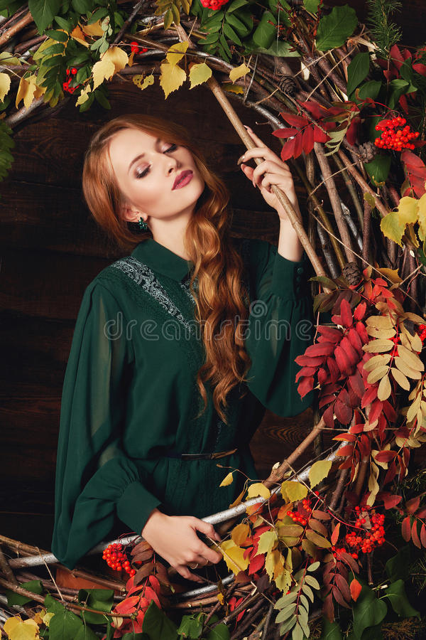 Beautiful girl with autumn decoration. Beautiful girl in studio with autumn decoration on wooden background.beauty fashion young woman royalty free stock photos
