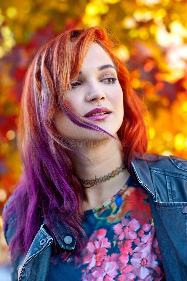 Beautiful girl in autumn scene stock photo