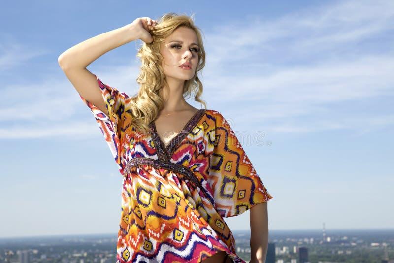 Beautiful girl on background blue sky royalty free stock photo