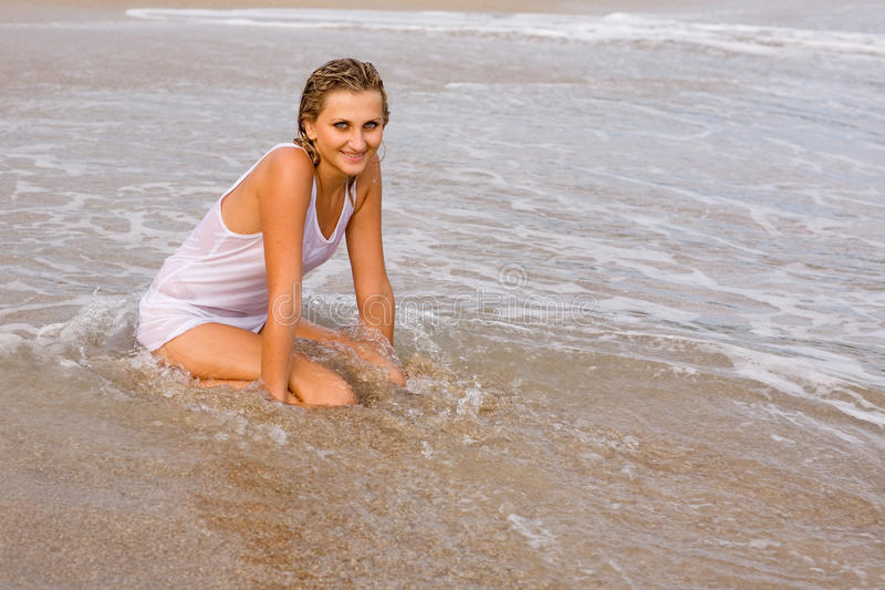 Beautiful girl on the beach. Attractive young blond girl on the beach. Summer stock images