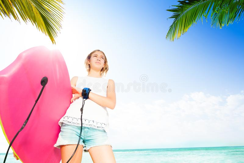 Girl with body board for swimming near the sea stock photo