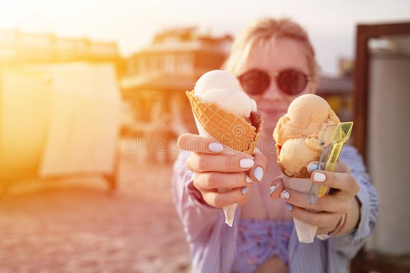 Beautiful girl on the beach with two big ice cream cones i stock image