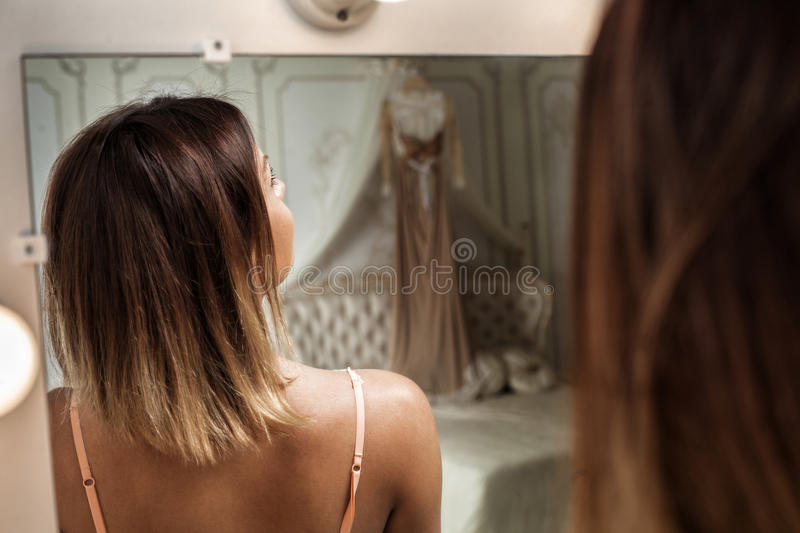 Beautiful girl in the bedroom royalty free stock photos