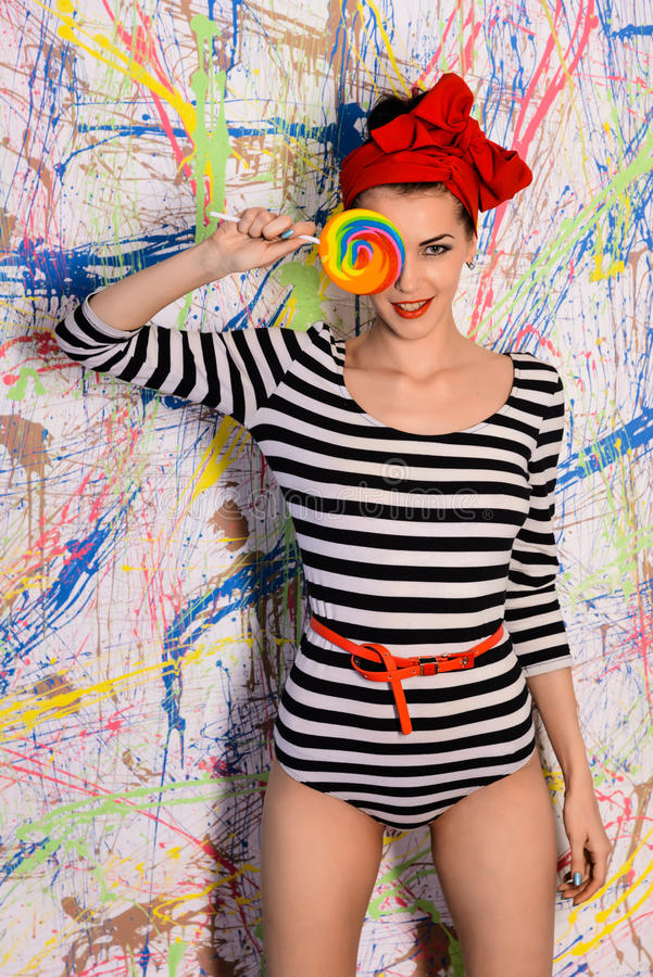 Beautiful girl with big lollipop royalty free stock image