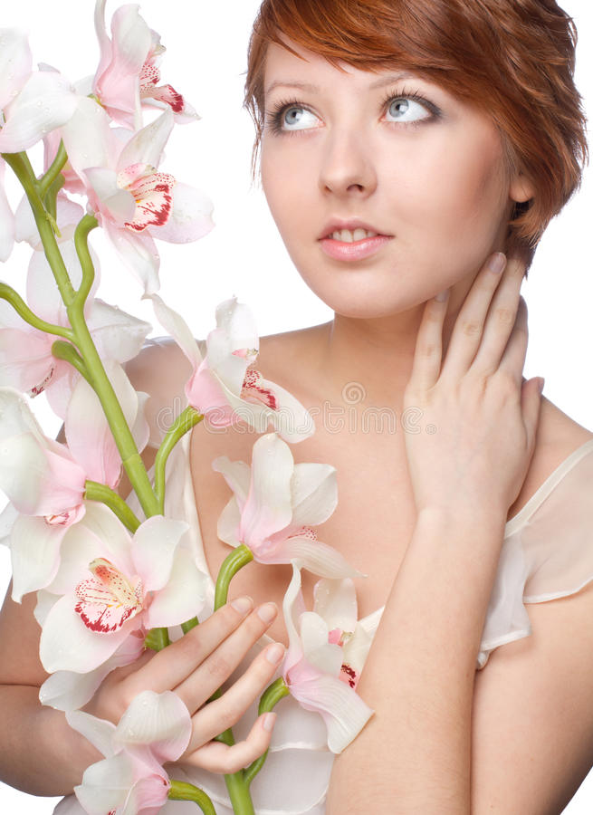 Beautiful girl with big orchid on white. Background stock photography