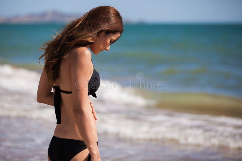 Beautiful girl on a bikini. Young woman wearing a bikini at the beach royalty free stock photography