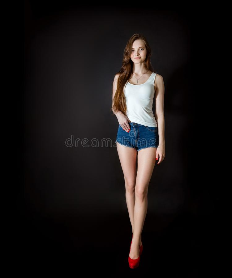Beautiful girl on a black background royalty free stock photography