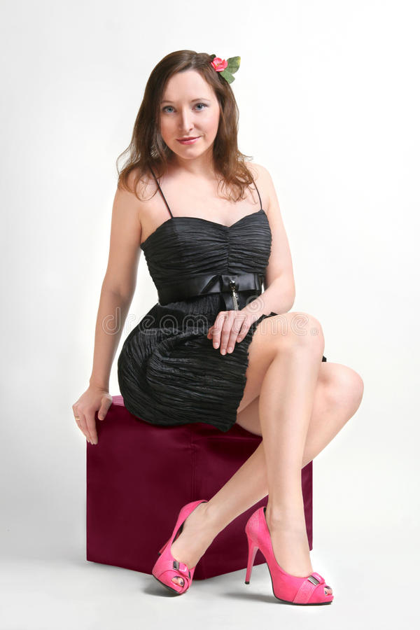 Beautiful girl in a black dress royalty free stock image