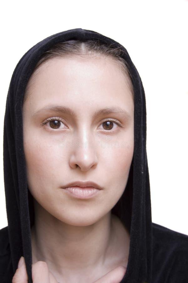 Beautiful girl in black hood, close up royalty free stock photo