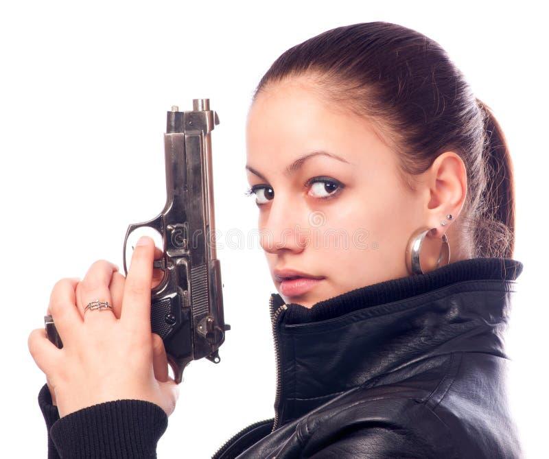 Beautiful girl in black leather jacket holding gun stock photos