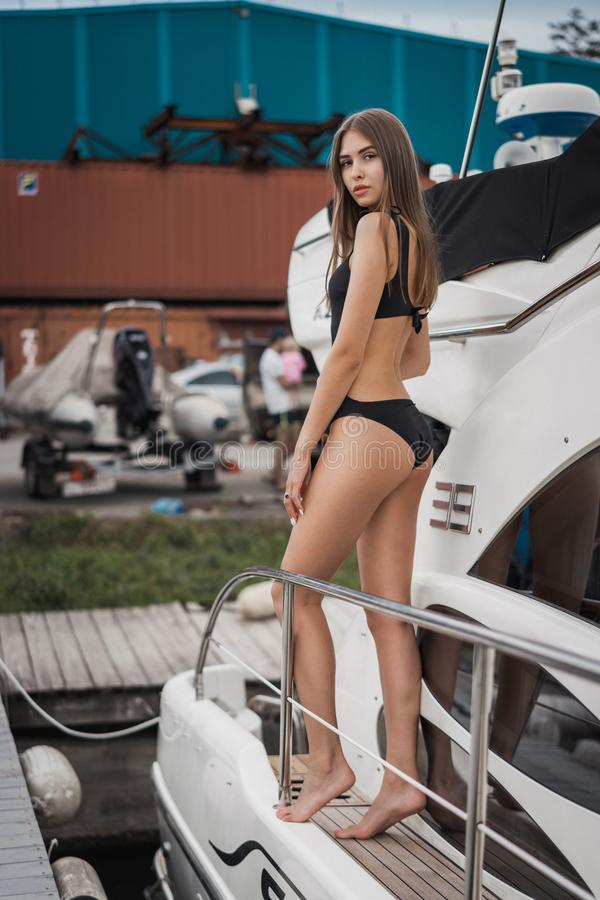 Beautiful girl in swimsuit on a boat stock photo