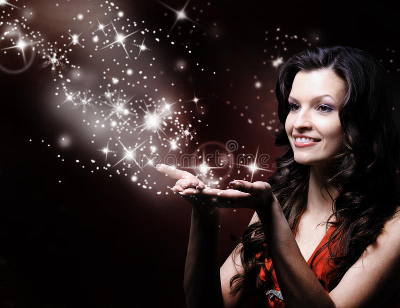 Beautiful girl blowing magic stock image