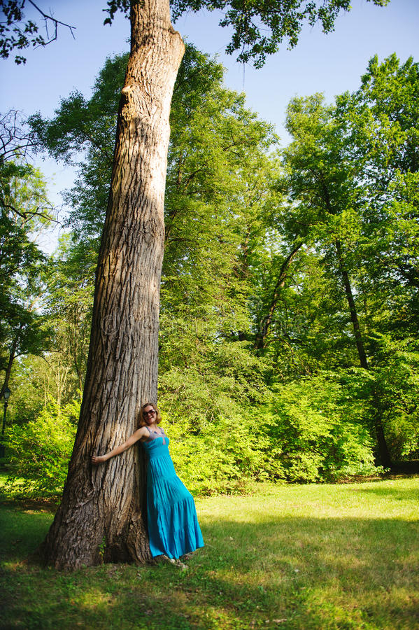 Download Beautiful Girl In Blue Dress Near Tree Stock Photo - Image: 25811846