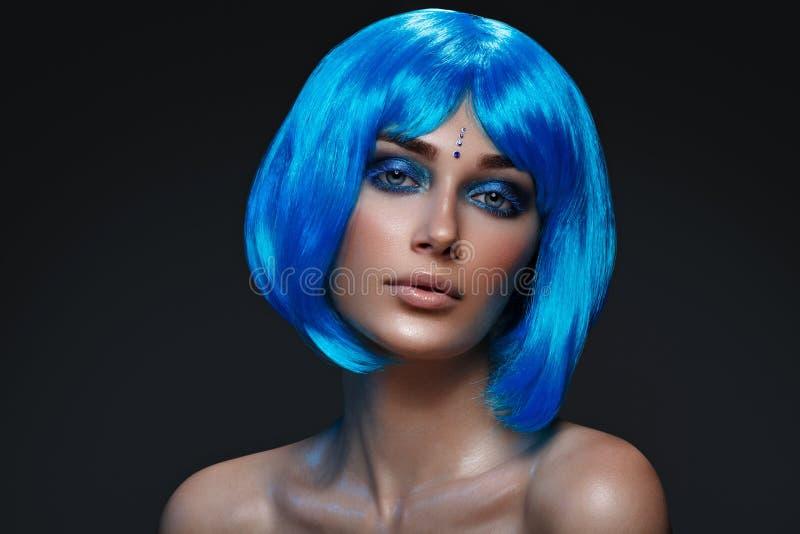 Beautiful girl in blue wig stock photos