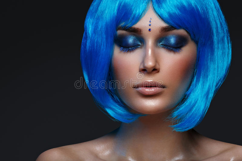 Beautiful girl in blue wig royalty free stock photography