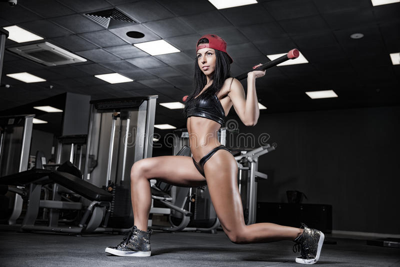 Beautiful girl bodybuilder , execute exercise with dumbbells, in royalty free stock photography